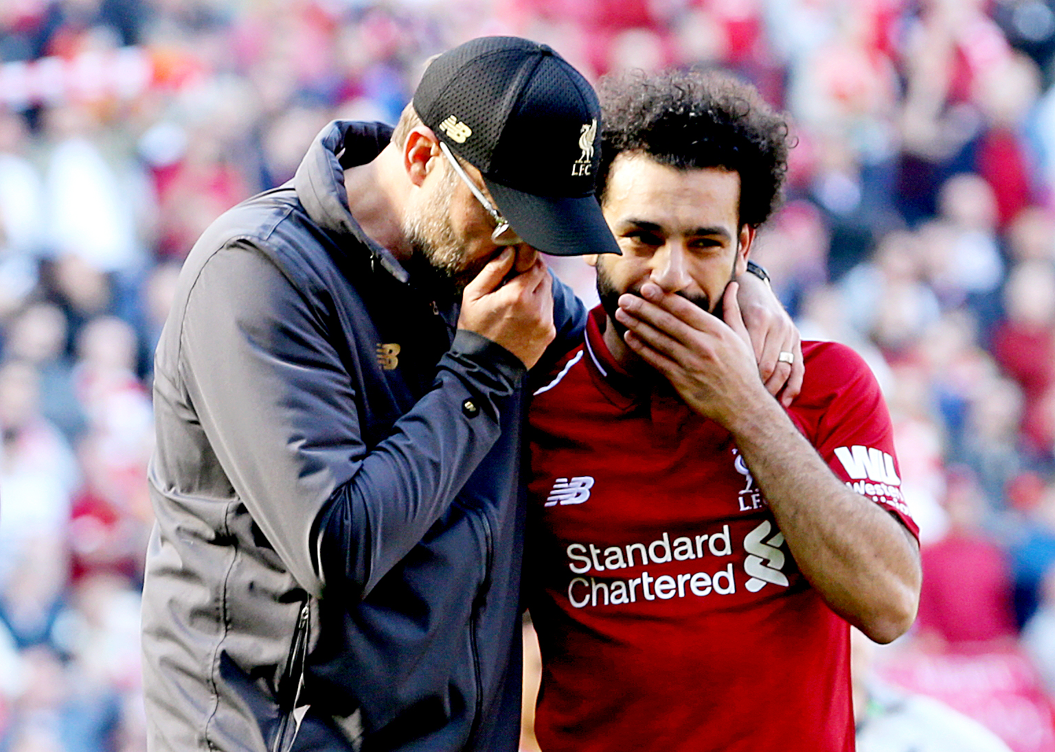 Jurgen Klopp and Mohamed Salah.