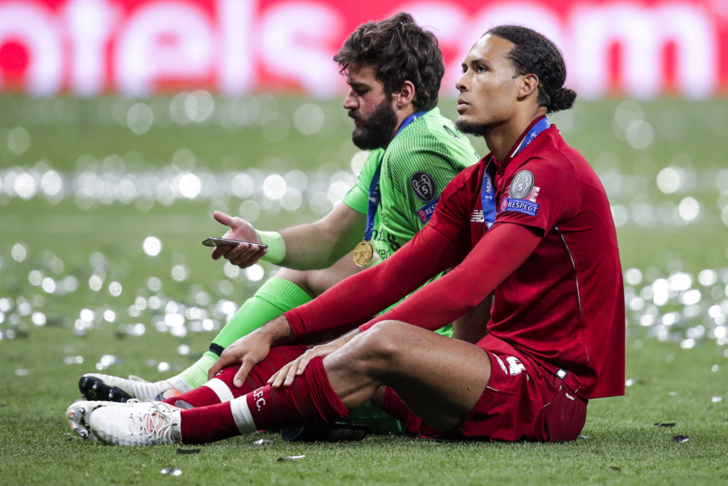 Alisson Becker and Virgil van Dijk.