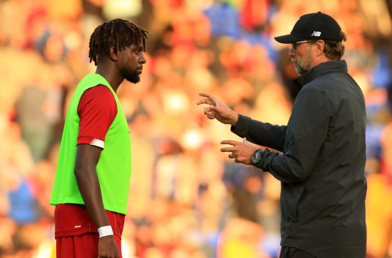 Divock Origi and Jurgen Klopp.
