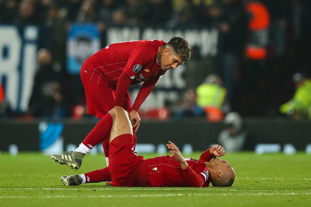 Roberto Firmino and Fabinho after the latters injury