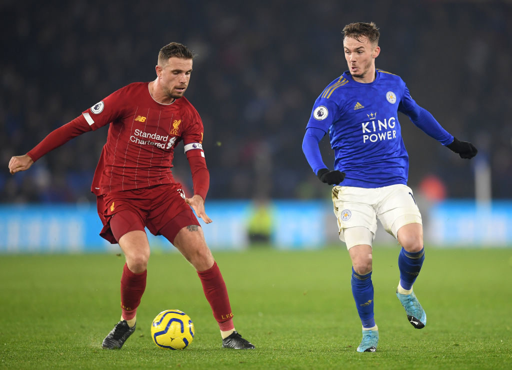 Jordan Henderson keeps the ball away from James Maddison