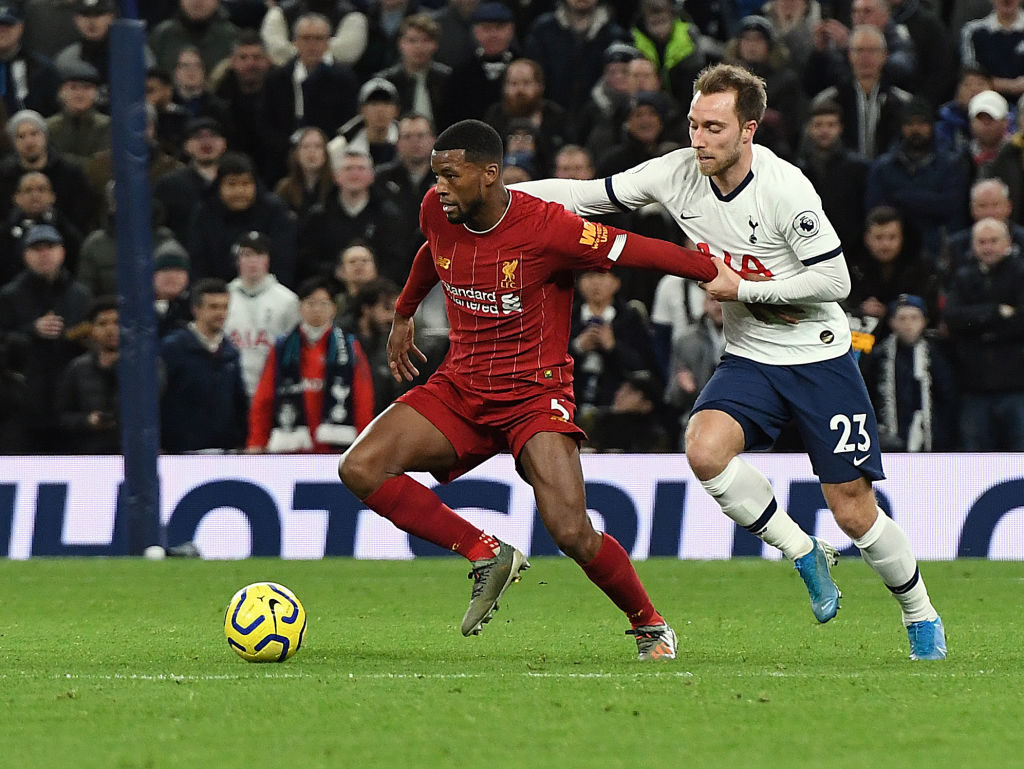 Gini Wijnaldum shields the ball from Christian Eriksen.