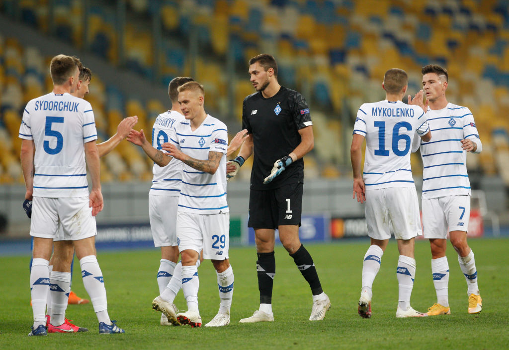 Dynamo players celebrate after the second leg of the play-...