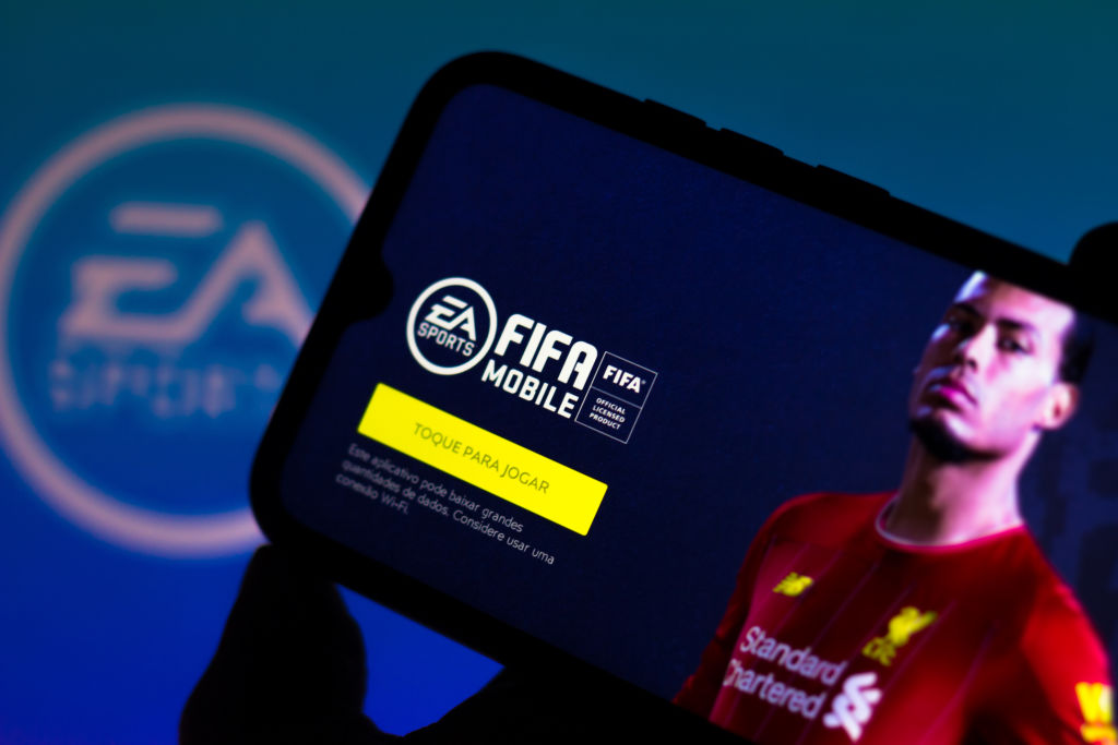In this photo illustration the FIFA 21 logo is displayed on...