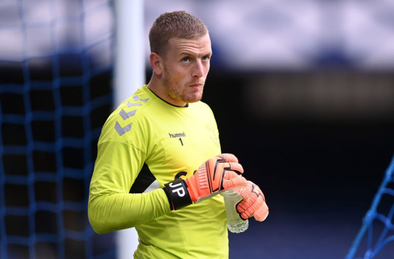 Jim Beglin has called for Jordan Pickford to be punished for his lunge at Virgil van Dijk