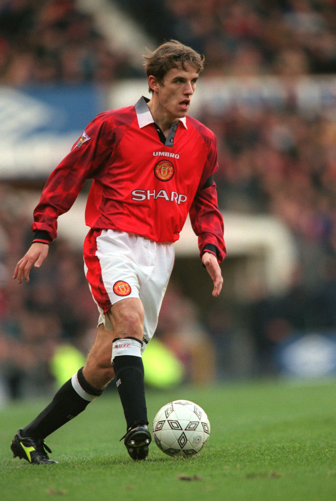 Phil Neville believes Liverpool will be challenged by Manchester United this season.