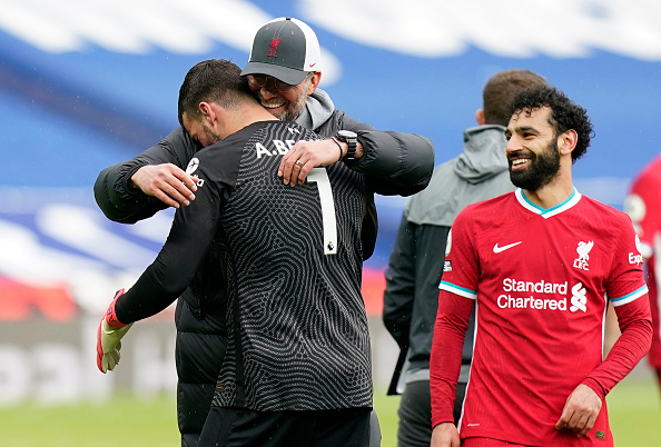 Jurgen Klopp celebrates victory with Alisson of Liverpool following the Premier League match between West Bromwich Albion and Liverpool at The Hawthorns