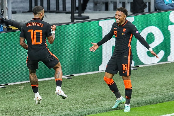 Donyell Malen after his assist for Memphis Depay