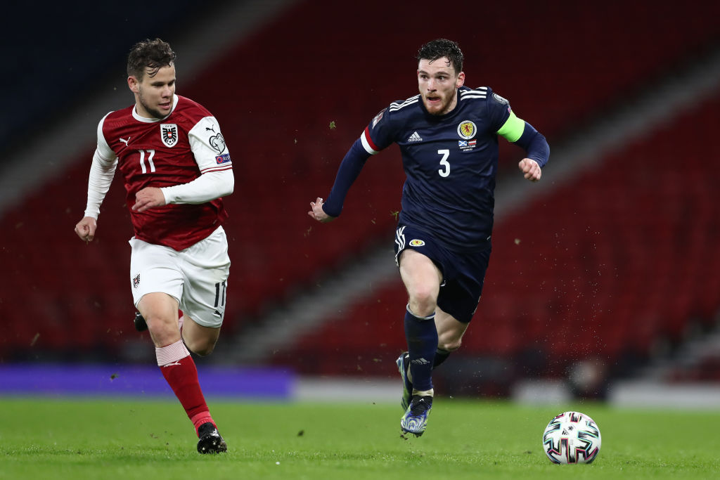 Andy Robertson of Scotland runs with the ball whilst under pressure from Louis Schaub of Austria during the FIFA World Cup 2022 Qatar qualifying match between Scotland and Austria on March 25, 2021
